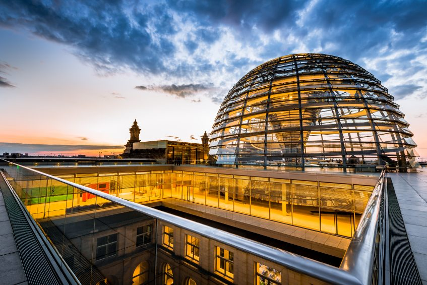 Outside the illuminated Reichstag Dome at Twilight. Spiral walkways to the top of the Reichstag, Germany's parliament building in the heart of Berlin, Central Berlin, Germany.